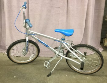 "BMX Bike, High Quality Performance Bicycle, Bluw Seat And Grips, Silver Aluminum Frame With Black Rear Tire Pegs, Warehouse, Blue, Silver, Bike Or Moped, STDRESSING, No Visible Wear And Tear, 58""L, 28""W, 36""H, PK Ripper, Aluminum, Rubber, Not Applicable"