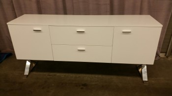 "Credenza, White, Chrome Legs, 2 Doors, 2 Shelves, 2 Drawers, Chrome Pulls, Warehouse, White, Chrome-plated, Credenza, Office, Good, 69""W, 32.5""H, 18""D, Wood, Metal"